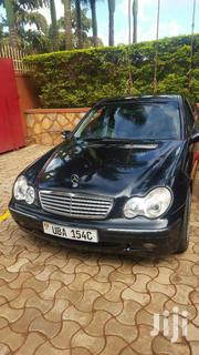 Black Classic Mercedese Benz C200 Uba Petrol In Great Condition | Cars for sale in Western Region, Kisoro
