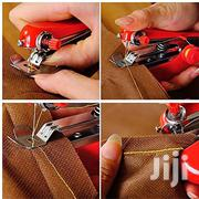 Portable Hand-held Mini Sewing Machine Fabric Pocket 4 DIY Needlework | Hand Tools for sale in Central Region, Kampala