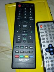 Sharp Flat Screen Television Remote And Geepas DVD Remote | Accessories & Supplies for Electronics for sale in Central Region, Kampala