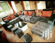 U Sofa, Glass Centre Table And 2 Poufs.   Furniture for sale in Central Region, Kampala