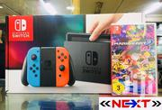 Nintendo Switch 32GB With Mario Kart 8 Deluxe Portable Hand Held Game | Video Game Consoles for sale in Central Region, Kampala
