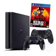 PS4 Slim 500GB With 2 Controllers & Redemption 2 Game | Video Game Consoles for sale in Central Region, Kampala