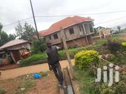 A Plot Of 50x100fts With 10 Double Rooms For Sale At 200m With Title | Houses & Apartments For Sale for sale in Central Region, Kampala