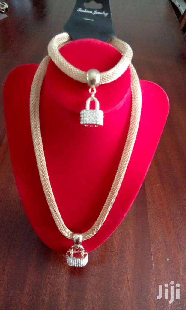 Gold Tone Necklace With Paddlock Pendant And Bracelet Set