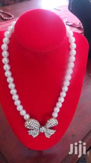 Pearl Beaded Ribbon Pendant Charm Necklace | Jewelry for sale in Central Region, Kampala
