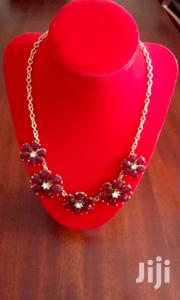 Gold Chain Necklace With Flower Shaped Ruby Stones Necklace | Jewelry for sale in Central Region, Kampala