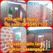 Cheap Plot With Ahouse on Wall Plate for Sale at 15million | Land & Plots For Sale for sale in Central Region, Kampala