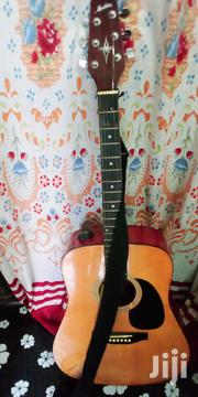 Acoustic Guitar With New Extra 6 Guitar Strings | Musical Instruments for sale in Central Region, Kampala